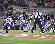 Ole Miss' Brandon Bolden (34) is tackled by Louisiana Tech's Jay Dudley (45) and Louisiana Tech's Terry Carter (28) in Oxford, Miss. on Saturday, November 12, 2011.