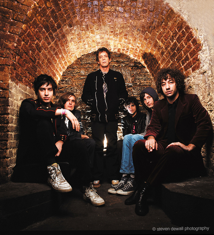 Lou Reed poses with the Strokes at Lit bar in NYC during an interview and cover shoot with the Strokes for Filter Magazine in 2004.