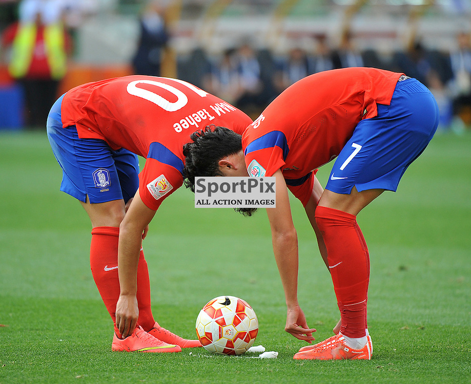 NAM TAE HEE (Korea Republic) and SON HEUNG MIN (Korea Republic).<br /> The Korea Republic V Uzbekistan 2015 Asian Cup quarter final game, being held at the Rectangular Stadium (Aami Park), Melbourne, Victoria, Australia on the 22nd January 2015<br /> Wayne Neal   SportPix.org.uk