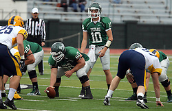 18 October 2014:  Donovan Laible (QB)  under center Niall Mulcahy during an NCAA division 3 football game between the Augustana Vikings and the Illinois Wesleyan Titans in Tucci Stadium on Wilder Field, Bloomington IL