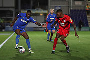 AFC Wimbledon attacker Michael Folivi (17) taking on Leyton Orient defender Marvin Ekpiteta (5) during the Leasing.com EFL Trophy match between AFC Wimbledon and Leyton Orient at the Cherry Red Records Stadium, Kingston, England on 8 October 2019.