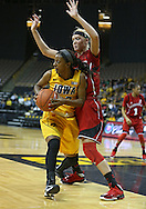February 11 2013: Iowa Hawkeyes guard Theairra Taylor (23) looks to pass as she is guarded by Nebraska Cornhuskers forward Emily Cady (23) during the first half of the NCAA women's basketball game between the Nebraska Cornhuskers and the Iowa Hawkeyes at Carver-Hawkeye Arena in Iowa City, Iowa on Monday, February 11 2013.