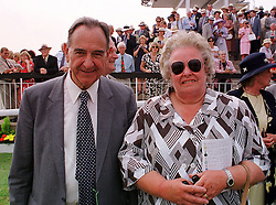 LORD COWDREY OF TONBRIDGE and his wife top trainer LADY HERRIES, at a race meeting in West Sussex on 30th July 1999.MUP 138