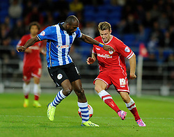 Cardiff City's Anthony Pilkington is challenged by Wigan Athletic's Emmerson Boyce - Photo mandatory by-line: Dougie Allward/JMP - Mobile: 07966 386802 19/08/2014 - SPORT - FOOTBALL - Cardiff - Cardiff City Stadium - Cardiff City v Wigan Athletic - Sky Bet Championship
