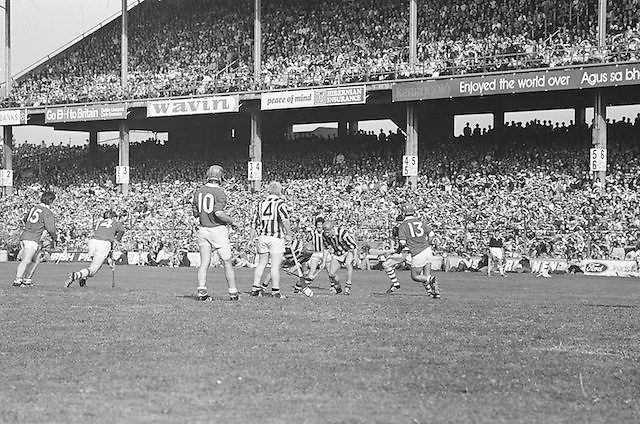 Kilkenny players surround slitor attempting to pick it up during at the All Ireland Senior Hurling Final, Cork v Kilkenny in Croke Park on the 3rd September 1972. Kilkenny 3-24, Cork 5-11.