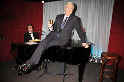 "PAUL O'GRADY at a party to promote the ""American Songbook in London"" aseries of intimate concerts featuring 1959 Broadway songs, held at Pizza on The Park, Hyde Park Corner, London on 18th March 2009."