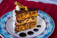 Caramel, Fudge, Coconut & Orange Mousee Cake