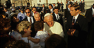 Pope John Paul II talks with people in crowd during a visit of Pope John Paul II to the USA in 1987.  Photograph by Dennis Brack...Photograph by Dennis Brack bb 28