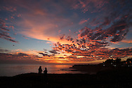 Friends watching the sunset, West Cliff Drive, Santa Cruz, California