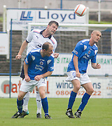 Dundee's Craig McKeown clears from Queen of the South's Allan Johnston and Tom Brighton during the IRN BRU Scottish Football League First Division match between Queen of the South and Dundee at Palmerston..© David Young.5 Foundry Place.Monifieth.Angus.DD5 4BB.Tel: 07765 252616.email: davidyoungphoto@gmail.com.http://www.davidyoungphoto.co.uk