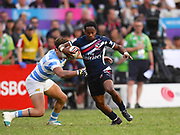 USA player Carlin Isles beats a tackle to score a try in the game USA vs Argentina during the Cathay Pacific/HSBC Hong Kong Sevens festival at the Hong Kong Stadium, So Kon Po, Hong Kong. on 8/04/2018. Picture by Ian  Muir.