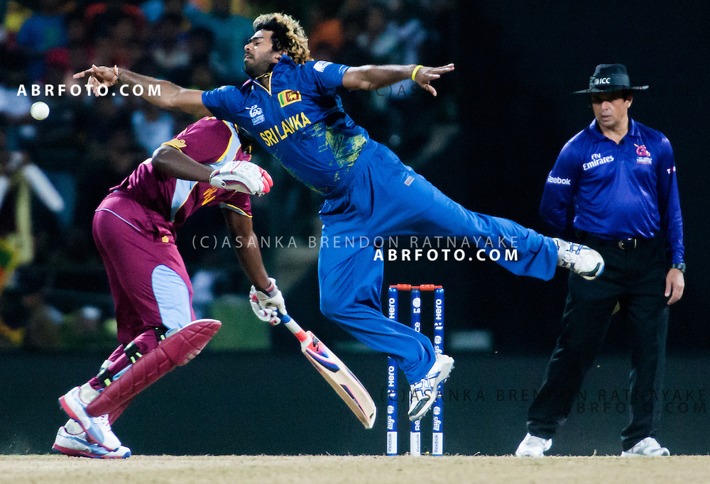 Lasith Malinga dives to stop the ball of his bowling during the ICC world Twenty20 Cricket held in Sri Lanka.
