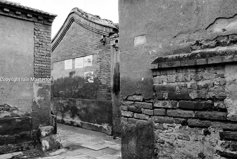 Old walls of houses in a narrow Beijing hutong