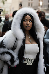 Nicki Minaj came to the fashion show in a heavy fur coat on an 80 degree day. 11 Sep 2017 Pictured: Nicki Minaj posed for the paparazzi in a fur coat. Photo credit: MEGA TheMegaAgency.com +1 888 505 6342