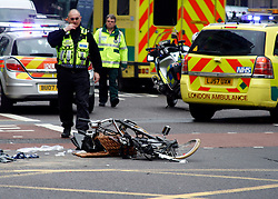 29/03/11 © under license to London News Pictures. A crushed bicycle  lies in the road. A Road traffic accident involving a cyclist shortly after 10am in London today (Tues). The accident happened at the junction of Gordon Street and Euston Road NW1 in front of the Welcome Trust an nearby Euston Station. Police and ambulance crews are in attendance. Police say the casualty has been taken by road ambulance to nearby University College Hospital Euston Road is closed to traffic westbound causing major traffic congestion.