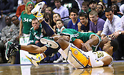 March 28, 2011; Indianapolis, IN, USA; Boston Celtics shooting guard Ray Allen (20) and Indiana Pacers forward Danny Granger (33) scramble for the ball at Conseco Fieldhouse. Indiana defeated Boston 107-100. Mandatory credit: Michael Hickey-US PRESSWIRE
