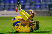 AFC Wimbledon midfielder Ayoub Assal (38) on the floor in pain during the EFL Trophy match between Southend United and AFC Wimbledon at Roots Hall, Southend, England on 13 November 2019.