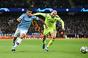 Dinamo Zagreb defender Marin Leovac (22) tries to stop Manchester City defender Joao Cancelo (27) during the Champions League match between Manchester City and Dinamo Zagreb at the Etihad Stadium, Manchester, England on 1 October 2019.