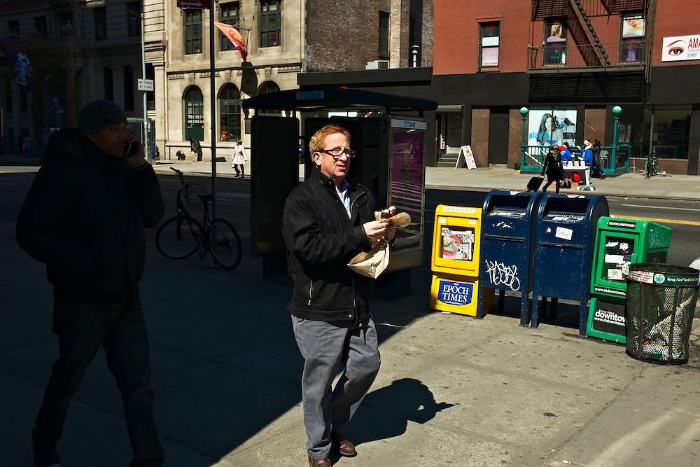 Man with donut, New York, NY, US