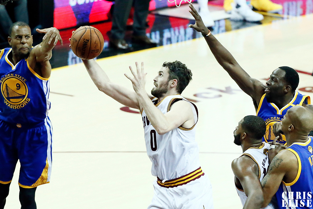 09 June 2017: Cleveland Cavaliers forward Kevin Love (0) grabs a rebound between Golden State Warriors forward Andre Iguodala (9) and Golden State Warriors forward Draymond Green (23) during the Cleveland Cavaliers 137-11 victory over the Golden State Warriors, in game 4 of the 2017 NBA Finals, at  the Quicken Loans Arena, Cleveland, Ohio, USA.
