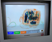 Peru - Wednesday, Dec 11 2002: The contents of a camera bag are displayed on the monitor of an X-ray baggage screening machine at Puerto Maldonado airport. (Photo by Peter Horrell / http://www.peterhorrell.com)