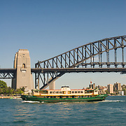 Passenger ferry passing Sydney Harbour Bridge
