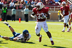 PALO ALTO, CA - OCTOBER 06: Running back Stepfan Taylor #33 of the Stanford Cardinal rushes past linebacker Hank Hobson #19 of the Arizona Wildcats during the third quarter at Stanford Stadium on October 6, 2012 in Palo Alto, California. The Stanford Cardinal defeated the Arizona Wildcats 54-48 in overtime. (Photo by Jason O. Watson/Getty Images) *** Local Caption *** Stepfan Taylor; Hank Hobson