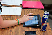 A student refrences her electronic textbook on her iPad while studying for a final exam late on Tuesday, March 15, 2011 in Copeland Hall.