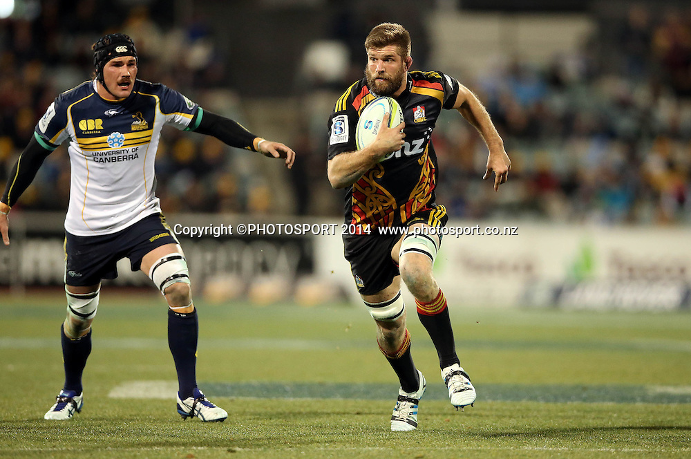 Michael Fitzgerald runs past Ben Mowen<br /> Super Rugby union qualifying finals match, Brumbies v Chiefs, Canberra, Australia. <br /> Saturday 19 July 2014. Photo: Paul Seiser/PHOTOSPORT
