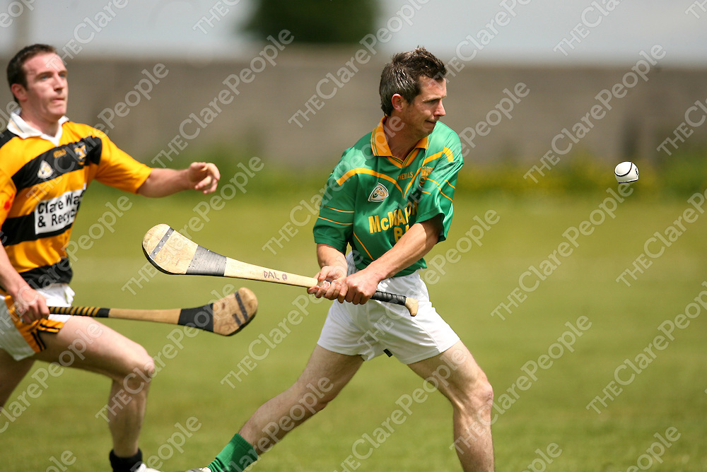 Bodyke's PJ Kelleher keeps the pressure on Ennistymon's Rory Daly during their clash in Clare Abbey on Sunday.<br />