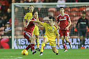 Burnley midfielder Joey Barton mussels with Middlesbrough midfielder Adam Forshaw during the Sky Bet Championship match between Middlesbrough and Burnley at the Riverside Stadium, Middlesbrough, England on 15 December 2015. Photo by Simon Davies.