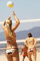 Young Woman Serving Volleyball