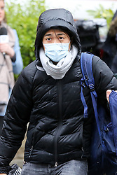 © Licensed to London News Pictures. 28/02/2020. London, UK. An Asian cameraman wearing a medical mask as a precaution against new type coronavirus (COVID-19) is seen on Abbey Road in central London.Two more people have tested positive for coronavirus in England, bringing the total number of UK cases to 15. Photo credit: Dinendra Haria/LNP