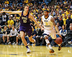Feb 12, 2018; Morgantown, WV, USA; West Virginia Mountaineers guard James Bolden (3) drives past TCU Horned Frogs forward Vladimir Brodziansky (10) during the second half at WVU Coliseum. Mandatory Credit: Ben Queen-USA TODAY Sports