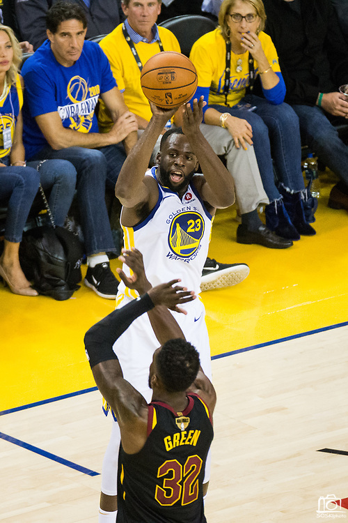 Golden State Warriors forward Draymond Green (23) shoots a three pointer over Cleveland Cavaliers forward Jeff Green (32) during Game 1 of the NBA Finals at Oracle Arena in Oakland, Calif., on May 31, 2018. (Stan Olszewski/Special to S.F. Examiner)