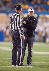 Oct 22, 2016; Morgantown, WV, USA; West Virginia Mountaineers head coach Dana Holgorsen talks with a referee during the fourth quarter against the TCU Horned Frogs at Milan Puskar Stadium. Mandatory Credit: Ben Queen-USA TODAY Sports
