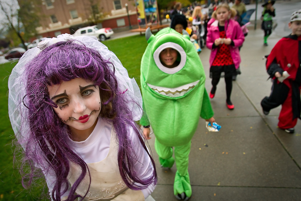 Taylor Wenglikowski walks along Sherman Avenue in her corpse bride costume Friday during the Sorensen Elementary Halloween Parade.