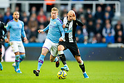 Jonjo Shelvey (#8) of Newcastle United wins possession of the ball from Kevin De Bruyne (#17) of Manchester City during the Premier League match between Newcastle United and Manchester City at St. James's Park, Newcastle, England on 30 November 2019.