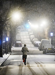 © Licensed to London News Pictures. 01/02/2019. London, UK. A man jogging in heavy snowfall in Maida Vale, West London as large parts of the UK are deluged with snow and freeing temperatures. Photo credit: Ben Cawthra/LNP