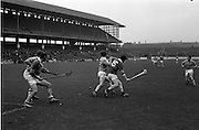 05/10/1969<br /> 10/05/1969<br /> 5 October 1969<br /> All-Ireland Junior (Home) Final: Kerry v Antrim at Croke Park, Dublin. <br /> Kerry full-forward, J. Lyannan (15) and Antrim full-back,  J. Mulhalland (2), tussle for the ball; while W. McCarthy (Kerry full-forward) and N McMullan (Antrim full-back) get ready to intercept the ball.