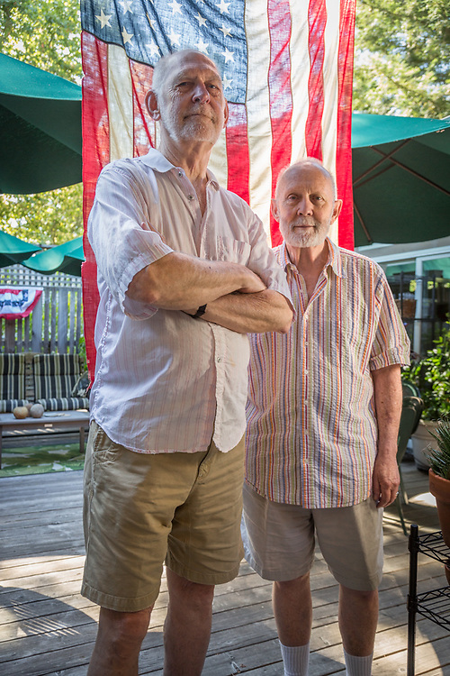 """""""We love the Fourth of July.  Years ago we started the Myrtle Street Deadenders Marching Kazoo Band and we marched in Calistoga's parade.  We did that until we couldn't march any more...those days are long gone.""""  - Jack Ramsey and Chris Zinn prepare for Fourth of July at their home on Myrtle Street in Calistoga"""