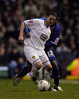 Photo: Jed Wee.<br /> Leeds United v Crystal Palace. Coca Cola Championship. 21/03/2006.<br /> <br /> Leeds' David Healy (L) holds off Crystal Palace's Mikele Leigertwood.