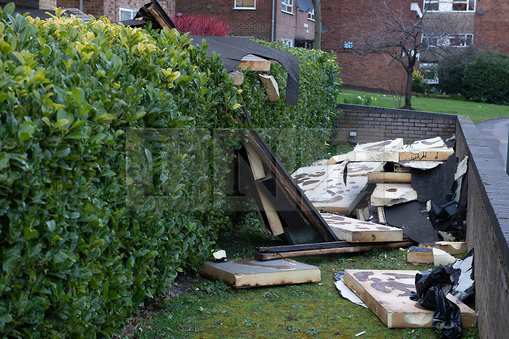 © Licensed to London News Pictures. 14/03/2019. Sidcup, UK. The roof has been blown off a small block of flats called The Elms in Sidcup by the windy weather this afternoon. The remains of the flat roof are in the front garden. Photo credit: Grant Falvey/LNP