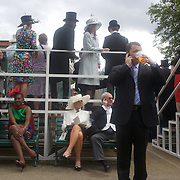 A scene near the parade ring as race goers relax between races during the race meeting at Royal Ascot Race Course. Royal Ascot is one of the most famous race meetings in the world, frequented by Royalty and punters from the high end of society to the normal everyday working class. Royal Ascot 2009, Ascot, UK, on Thursday, June 18, 2009. Photo Tim Clayton..