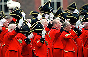 CHELSEA PENSIONERS WAVE THEIR HATS AT THE FOUNDERS DAY PARADE AT THE ROYAL HOSPITAL, CHELSEA, LONDON.