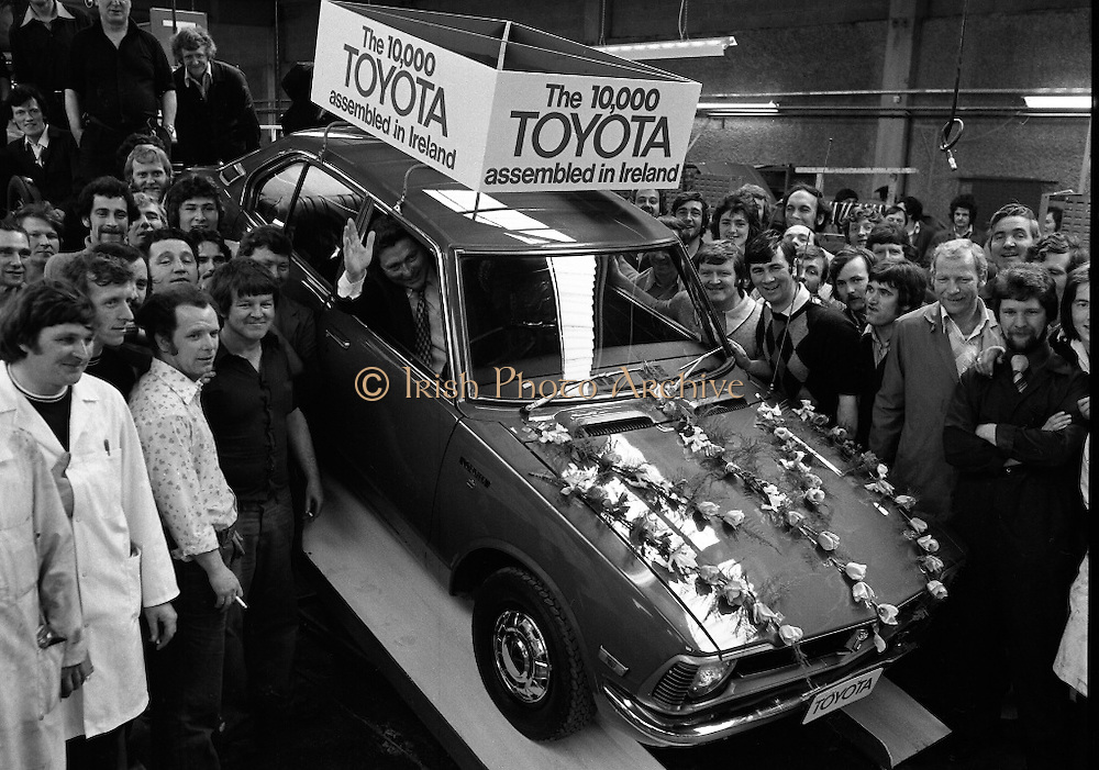 Toyota roll out 10,000th car assembled in Ireland..(L18)..1977..26.05.1977..05.26.1977..26th May 1977..Today saw the rolling out of the 10,000th car to come off the assembly line at Toyota Irl.,Ltd. The car,a Corolla,is part of a range that has made Toyota the fourth best selling range of cars in Ireland...Image shows Mr Tim Mahony,Chairman and Managing Director,Toyota Irl Ltd, surrounded by happy assembly workers as he take the wheel of the 10,000 Toyota  car assembled here..