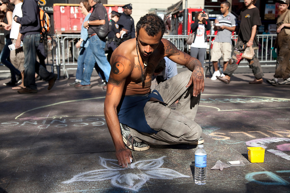 Zain Awadallah makes art on the concrete of Zuccotti Park in New York City, NY on October 10, 2011.