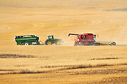 Combine harvesting durum wheat with grain cart<br /> Carmichael<br /> Saskatchewan<br /> Canada