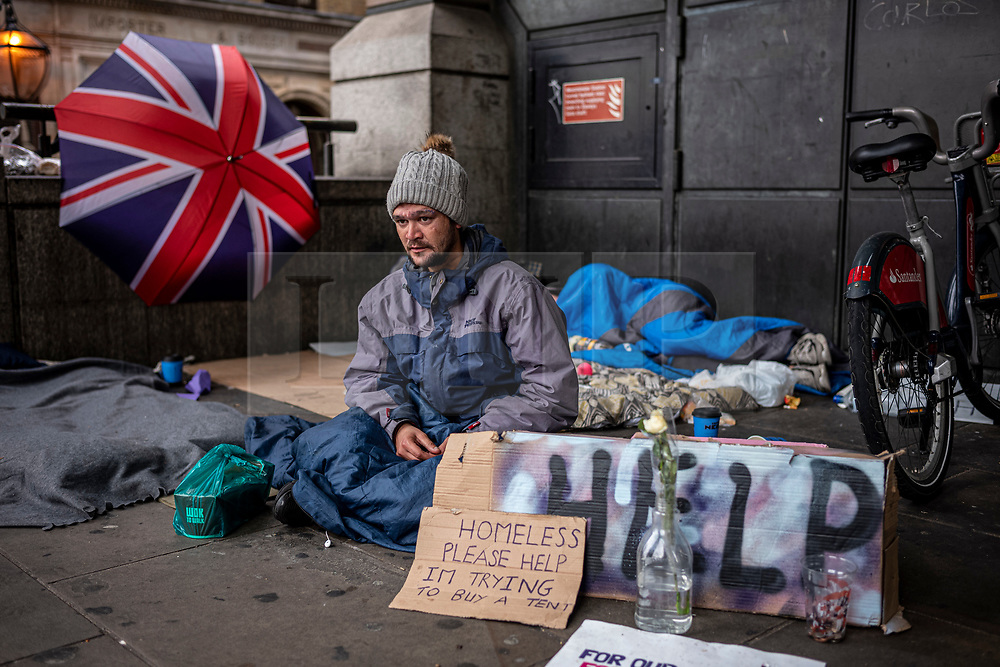 FILE IMAGE © Licensed to London News Pictures. 21/10/2019. London, UK. Freddy whose makeshift home of cardboard mattresses and lightweight blankets is in an arcade next to Westminster tube Station and less than 100 yards from the Houses of Parliament. He enjoys a meal or two from commuters that he gets to know. He has lived on the streets in Westminster for the past 7 years and is trying to raise money for a new tent that was mistakenly taken away by the Police during the XR demonstrations. Pictures highlight the reality of homelessness in Westminster taken during the build up of Brexit and the General election just a few hundreds yards from Parliament and Downing Street. Photo credit: Alex Lentati/LNP