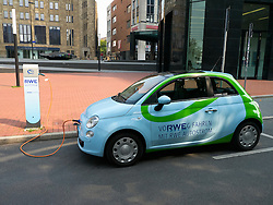 Fiat 500 electric car owned by power company RWE being recharged on street in Dortmund Germany